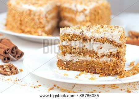 Slice of gourmet carrot cake with walnut crumbs and cinnamon