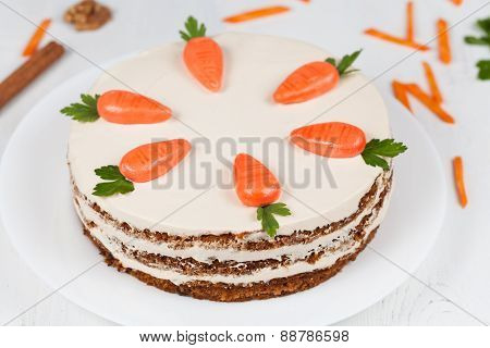 Tasty easter sponge cake with cream and little carrots on top
