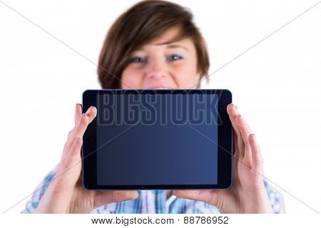 Pretty brunette showing tablet pc on white background