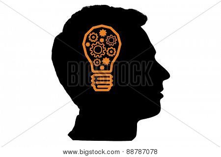 Light bulb with cogs against silhouette of head