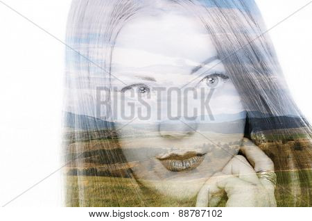 Double exposure photo of a young woman and mountain landscape