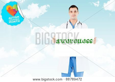 The word awereness and portrait of a doctor holding a blank panel against blue sky
