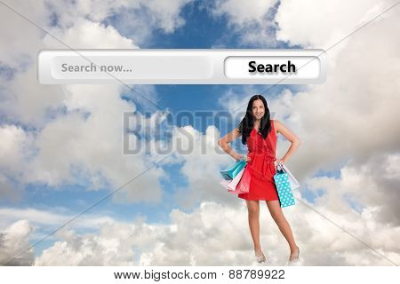 Woman standing with shopping bags against blue sky with white clouds