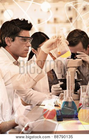 Science and medical graphic against scientists working in a laboratory