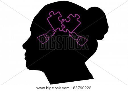 Hands forming jigsaw against silhouette of head