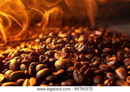 Pile of coffee beans with steam, closeup