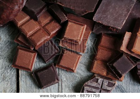 Set of chocolate on wooden table, closeup