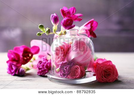 Beautiful composition with flowers on grey background