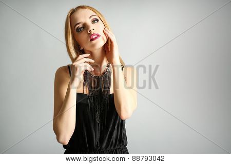 Portrait of expressive young model on gray background