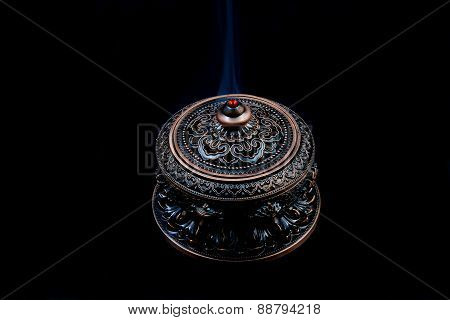 A Bronze Censer with Incense Smoke