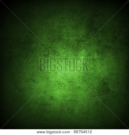 Green grunge textured wall. Dark edges. Advertising copy space