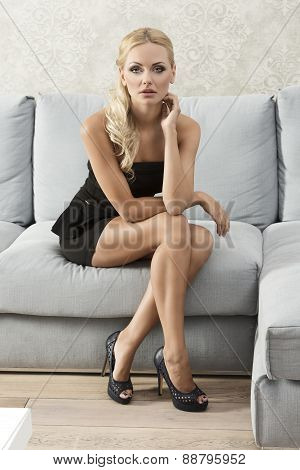 Elegant Woman On Sofa Posing