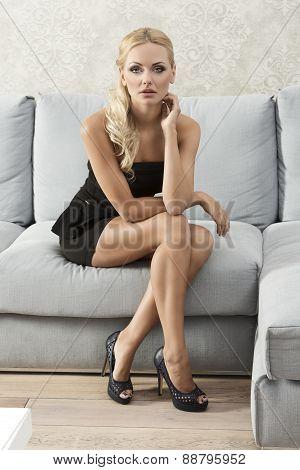Elegant Woman On Sofa Posing
