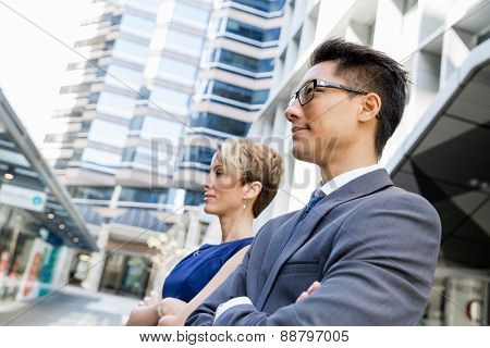 Businessteam members standing next to each other in business district