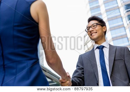 Businessman meeting his colleague outdoors