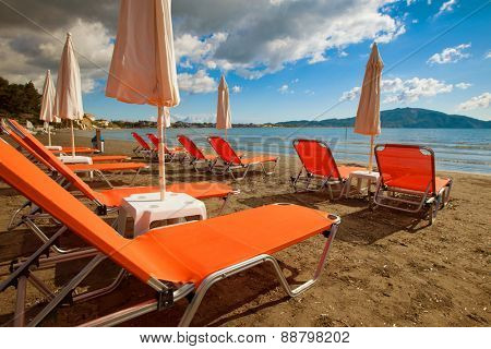 travel concept - sunchairs with  umbrellas on beautiful  beach, Zakynthos  island, Greece