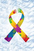foto of autism  - autism ribbon against crumpled white page - JPG