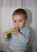 stock photo of flute  - Boy with Flute pretty young musician playing - JPG