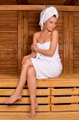 image of sauna woman  - Attractive young woman wrapped in towel spending time in sauna and keeping eyes closed - JPG