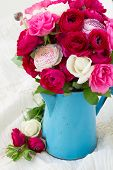 foto of bunch roses  - bunch of pink ranunculus and rose flowers in blue pot - JPG