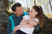 stock photo of 7-year-old  - A 10 years old girl enjoying a moment of fun with her dad - JPG