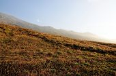 picture of mountain chain  - Hills lead to mountain chain of Sera which circulates the island of Fogo Cabo Verde - JPG