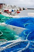 image of fleet  - Blue and green fishing nets in front of the fishing fleet in the harbour of Andenes - JPG