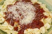 pic of glass noodles  - Italian pasta dinner served with Marinara sauce parmesan cheese over bow tie noodles accompanied by a glass of Chianti wine and bread - JPG