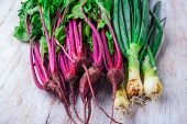 picture of beet  - Fresh beets and onions with chives on a white wooden table - JPG