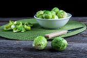 stock photo of brussels sprouts  - brussels sprouts on old wood table - JPG