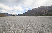 foto of cobblestone  - immense gravel bed of the river bed completely without water with many cobblestone and rocks - JPG