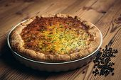 stock photo of crust  - Homestyle pie crust in rustic setting black pepper  - JPG