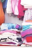 pic of wardrobe  - A wardrobe full of colored child clothes - JPG