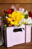pic of wooden crate  - Beautiful spring flowers in wooden crate - JPG