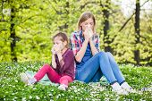 stock photo of blowing nose  - Two people with allergy symptom blow their noses - JPG
