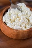 stock photo of curd  - curd in brown wooden bowl closeup - JPG
