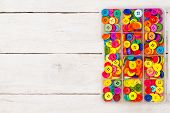 picture of sewing  - Colorful sewing buttons on a wooden background - JPG