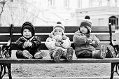 pic of three sisters  - three toddlers are sitting on the bench - JPG