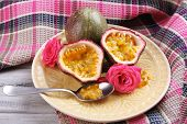 pic of passion fruit  - Passion fruit on plate on color wooden background - JPG