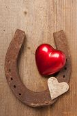 pic of horseshoe  - Red heart and a horseshoe on a wooden board