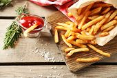 image of french fries  - Tasty french fries on cutting board - JPG