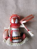 image of adornment  - Ukrainian handmade folk doll. Traditional fabric adornment.