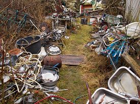 stock photo of scrap-iron  - Scrap metal iron junk garbage in a backyard  - JPG