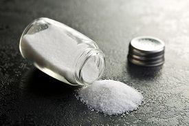 pic of salt shaker  - salt shaker on black kitchen table - JPG