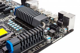 image of cpu  - Multiphase power system modern processor with heatsink and the CPU socket - JPG