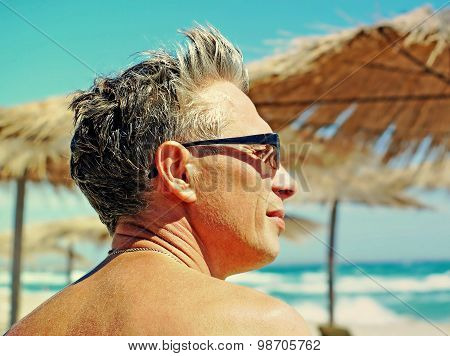 Romantic Man Face Against Of Blue Sky And Sea.
