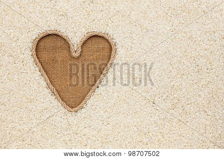 The Symbolic Heart Made Of Rope Lies On Sackcloth And Rice Grains