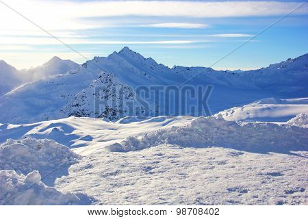 snow-capped peaks of the mountains