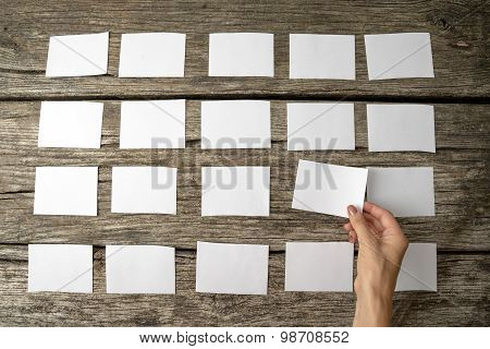 Woman Laying Out Blank White Memo Notes
