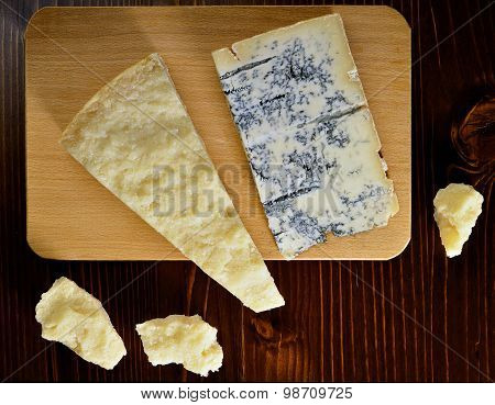 Cutting Board With Parmesan And Gorgonzola Cheese
